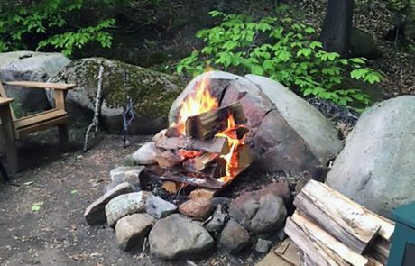 Roaring fire with picnic table.